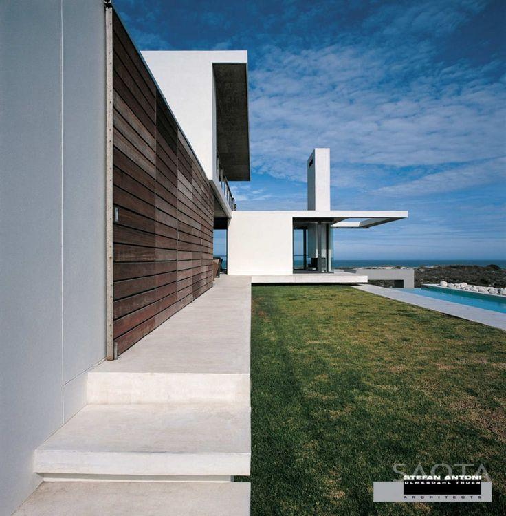 Wooden exterior sliding shutters.   Stefan Antoni Olmesdahl Truen Architects - Yzerfontein beach house, South Africa