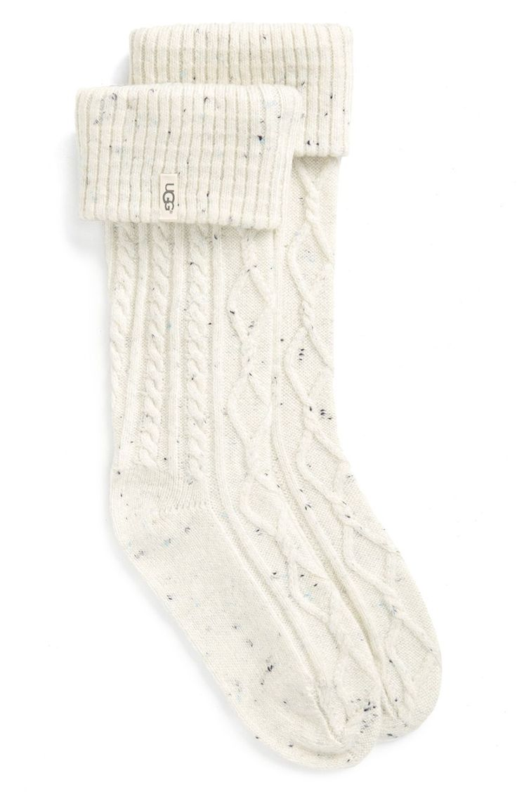A tall boot sock shaped from a supersoft blend of fabrics is topped with a cozy knit cuff—letting you add warmth and comfort to your favorite footwear.