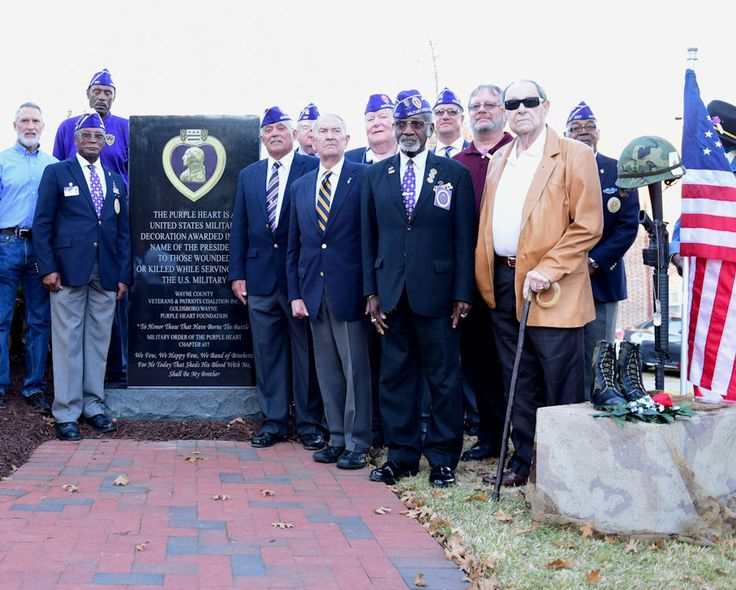 Recipients of the Purple Heart medal gather in front of the newly unveiled Purple Heart memorial at the Wayne County Veteran's Memorial, Goldsboro, North Carolina. The Purple Heart medal is awarded to service members wounded or killed during combat while serving in the armed forces.