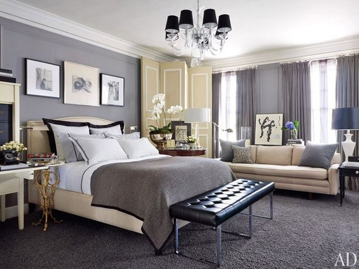 A chandelier by Williams-Sonoma Home overlooks a Kansas City, Missouri, master bedroom. The folding screen and sofa are vintage, the herring...