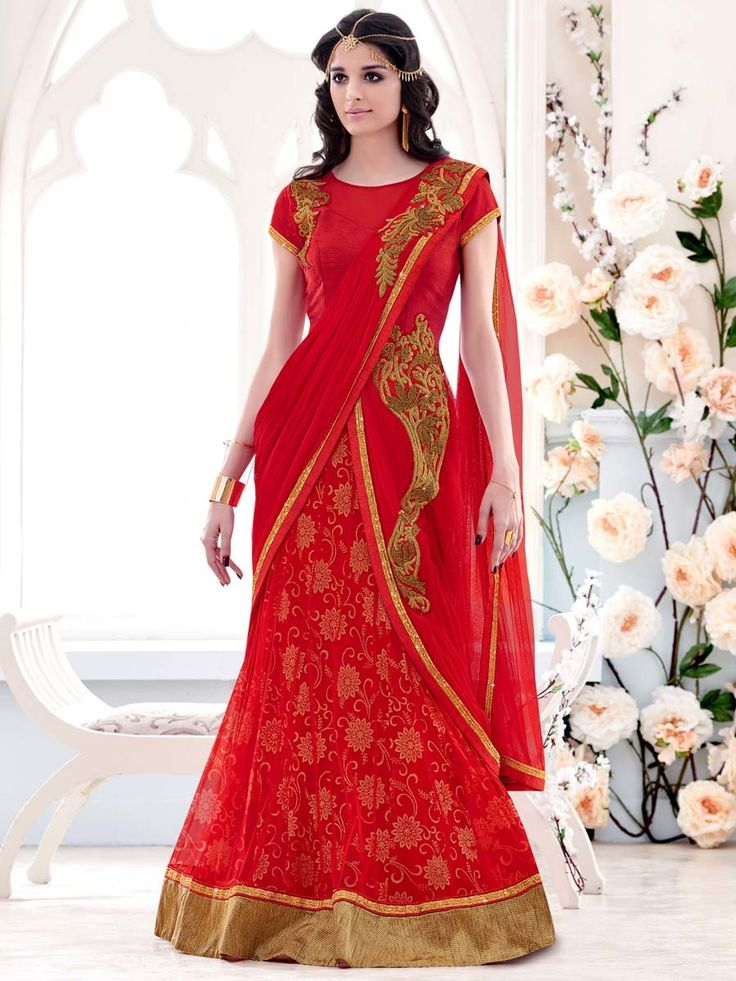 Charming red color net and lycra lehenga saree with floral print inner and zardosi, stones work. Item code: SAV3908 http://www.bharatplaza.com/new-arrivals/sarees.html
