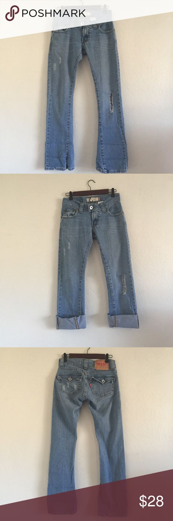 Levi 504 destroyed slouch jeans 3 Excellent condition worn once as crops! 99% cotton 1% spandex 15.5 in waist flat 7.5 in rise inseam 31 in ankle measurement 8.5. Any questions please ask! Levi's Jeans Straight Leg