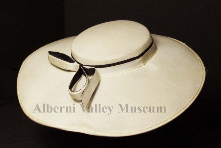 "In the late 1940s Christian Dior's ""New Look"" brought about the return of glamorous hats as accessories for the new dress designs.  Hat styles varied during this time, ranging from very large to quite small.  This example of a shallow-crowned hat with a wide brim was common. [Alberni Valley Museum Collection 1971.81.1i]"