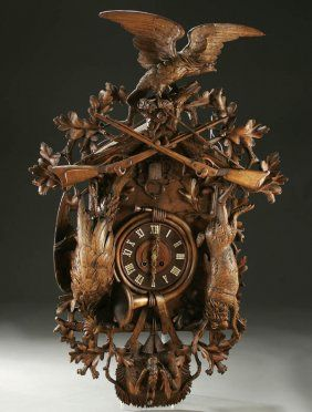 """My mom had something similar A MONUMENTAL SWISS """"BLACK FOREST"""" COO-COO CLOCK, CARVED WOOD circa 1910."""