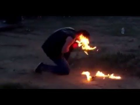 VIDEO:  Fire-breather sets his FACE alight during a Russian festival