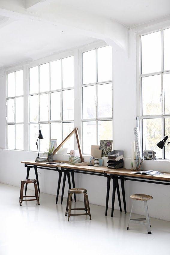 white walls, white floors, windows, desk, stools