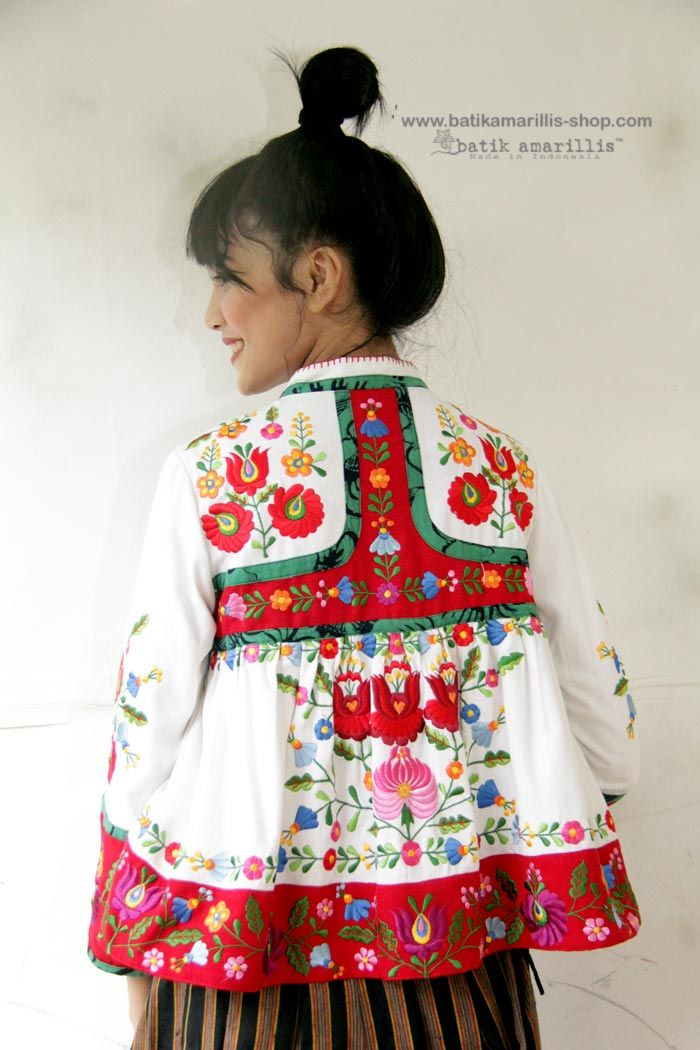 Batik Amarillis's Shikhara jacket Batik Amarillis webstore www.batikamarillis-shop.com Beautiful Hungarian embroidery on linen and which also features beautiful & colorful tassels This is Traditional Rabari ( Indian community in Gujarat ) male outfit's inspired ,consists of a fitted bodice with loosely gathered pleats down below with our patchwork's trademark, with front & back yoke make this tribal Look so unique & special!
