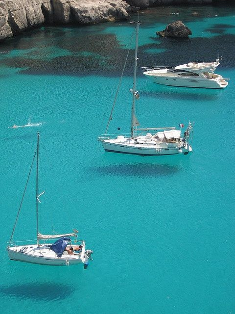With enough money you can make anything fly. Flying Boats (Tre barche che sembrano volare ~ Three boats that seem to fly) ~ Minorca ~ Balearic Islands ~ Mediterranean Sea  by FredMiller via Flickr