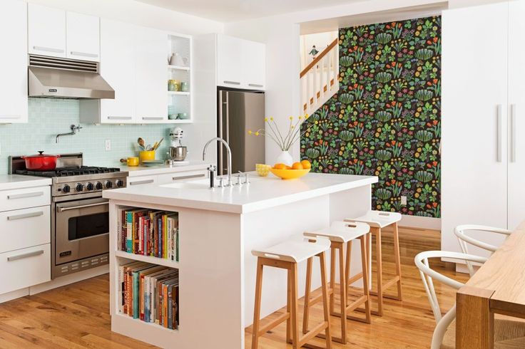 Use open-storage cabinets (it's a cinch to remove doors). Pick colors that complement the rest of the kitchen — the pale teals and yellows here echo the backsplash and Josef Frank wallpaper on the stairwell wall. Cookbooks are close at hand in the island thanks to clever shelving.  - GoodHousekeeping.com