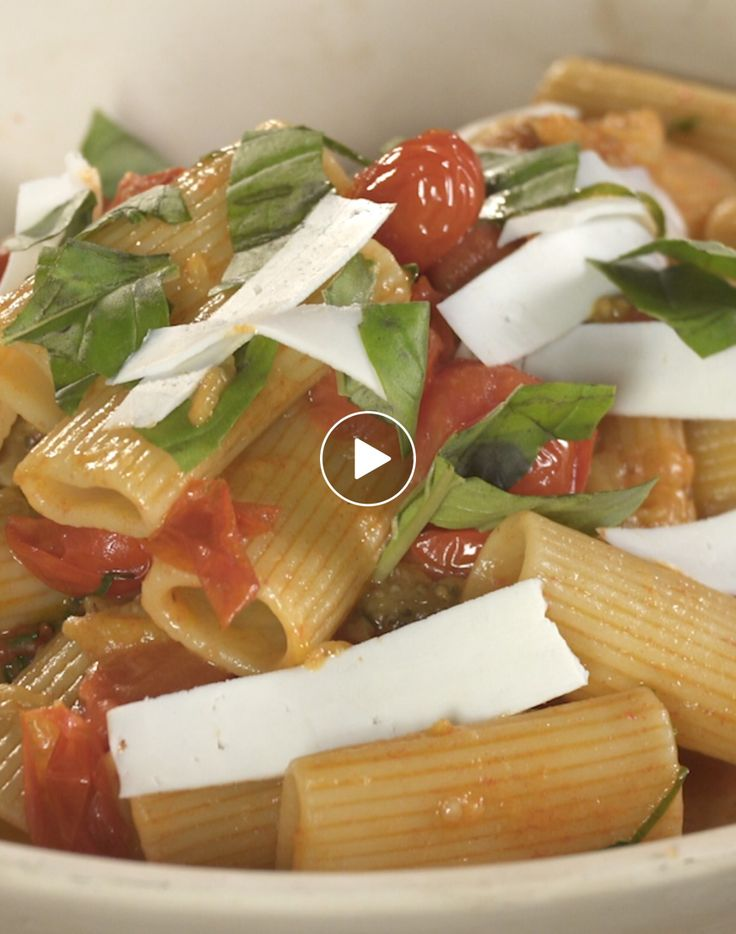 Rigatoni Alla Norma - Norma is used to decribe something is awesome, this dish is fulled with eggplant, cherry tomatoes and ricotta cheese.