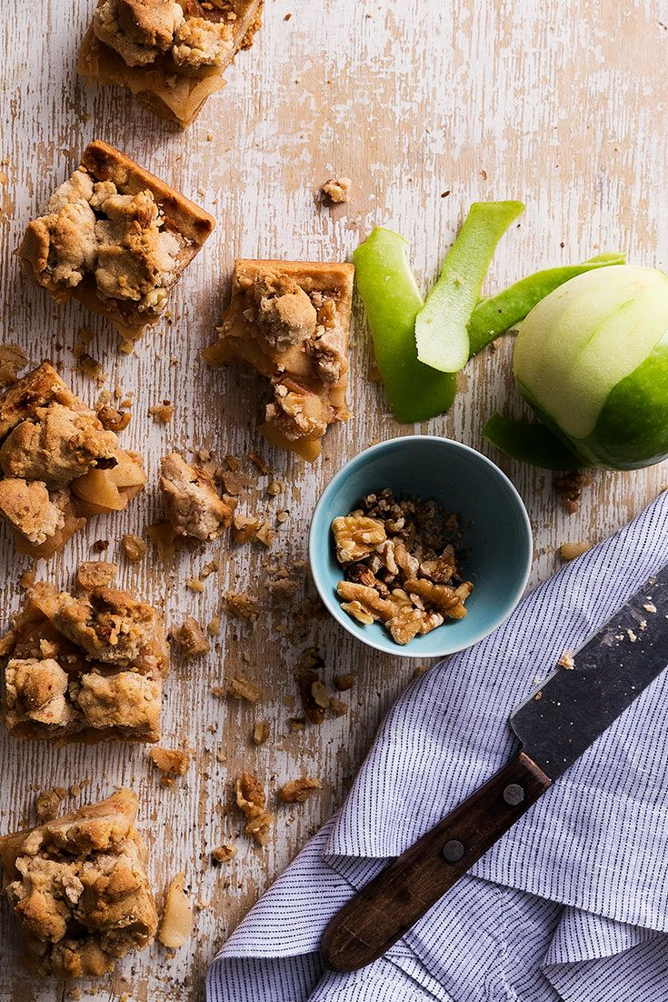 Sweet and tart apples are layered over buttery shortbread before getting topped with a crumble in these apple pie bars from Ina Garten.