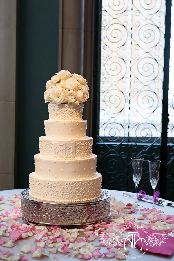 custom 5-tier buttercream wedding cake by The Fort Worth Club with a fresh floral topper