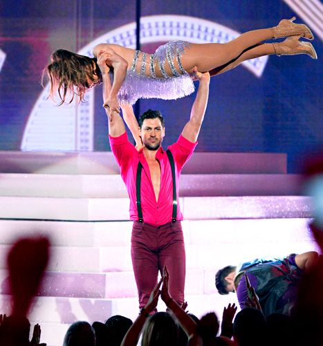 Jennifer Lopez Lifted Above Maksim Chmerkovskiy's Head Onstage at AMAs - Us Weekly