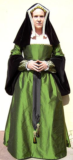 NINYA MIKHAILA - HISTORICAL COSTUMIER.c1520 costume made for Raphael Falconry (www.raphaelfalconry.fsnet.co.uk) consisting of a changeable green silk taffeta gown with large turnback sleeves in black velvet worn over a kirtle of black and green silk damask and black taffeta. English Hood of white silk taffeta and black velvet with gold/pearl trim.