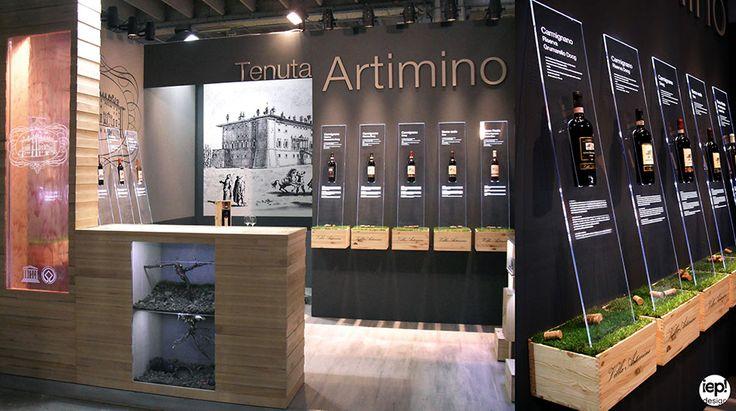Vinitaly 2015: Allestimento stand fieristico. Concept, layout, progettazione sistema espositivo e cascata di vino a colonna. Cliente: Artimino spa