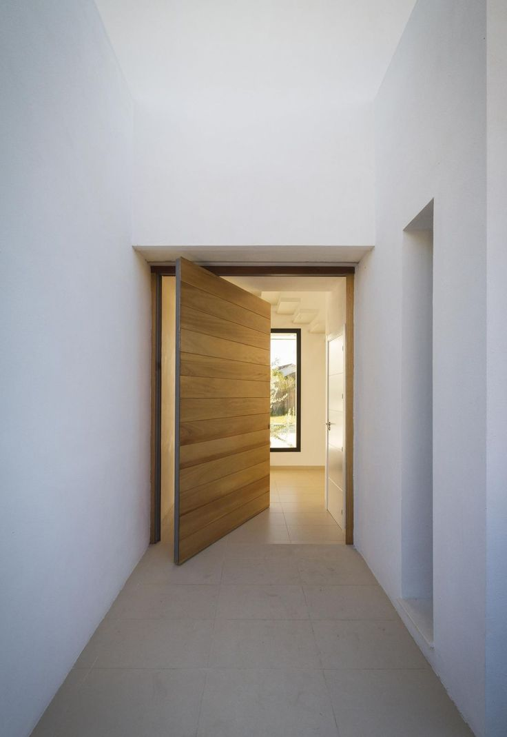 Ramos residence wood entry door