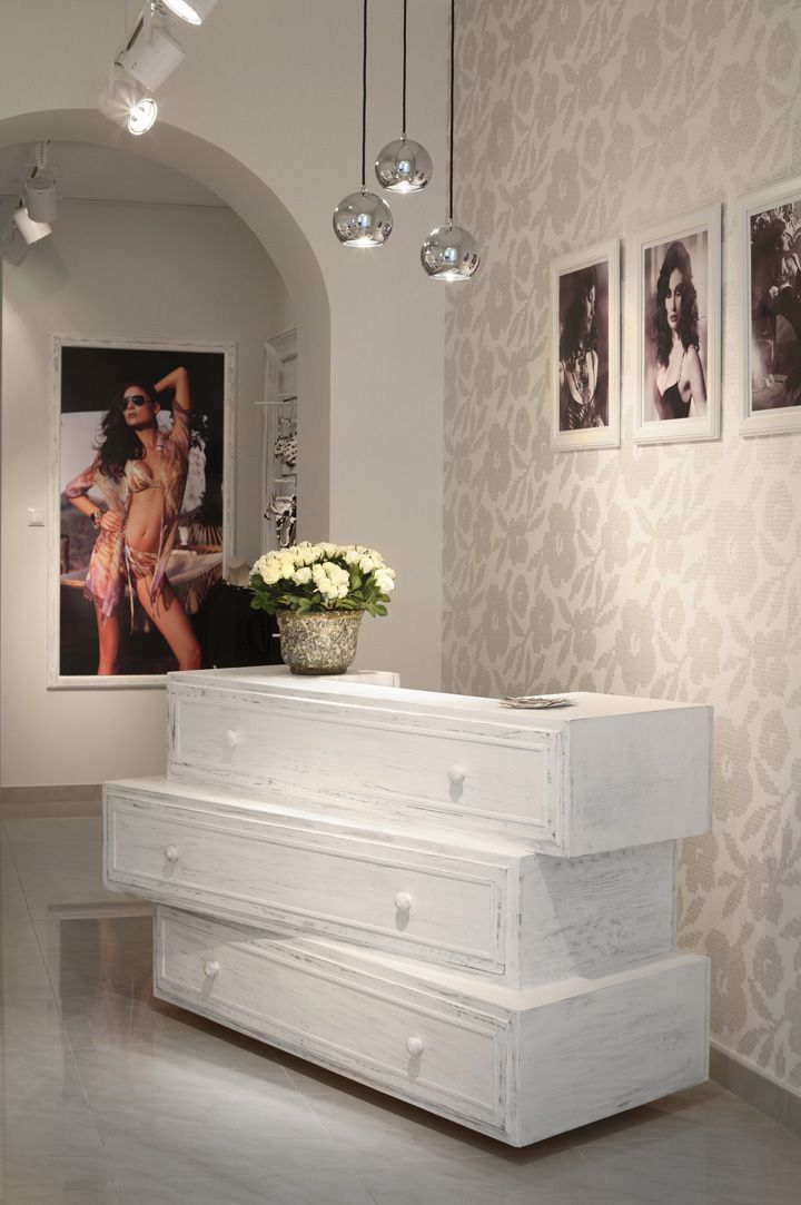 Point of Sale - stacked drawers   yes to pendant lamps, pictures, vase of flowers.