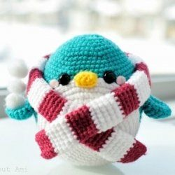 List of free crochet and amigurumi penguin patterns. Crochet a cute penguin ornament, crochet penguin bib, crochet penguin coaster, penguin toy...