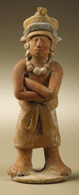 Pre-Columbian:Ceramics, Standing Male Dignitary with Folded Arms. Maya, Jaina. A.D. 550 -900. Ceramic, traces of original paint. Height 6 1/2 in. ...
