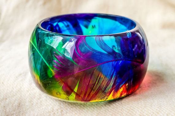 Parrot like feathers in colored transparent resin by PAGANEuniques