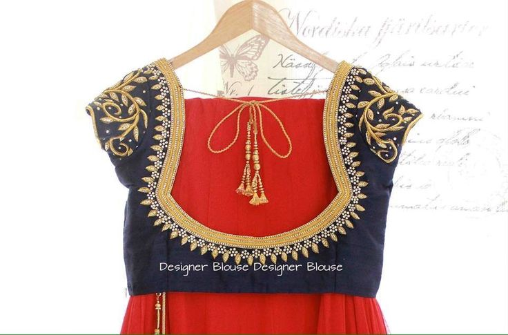 Embroidered black blouse with plain red Saree