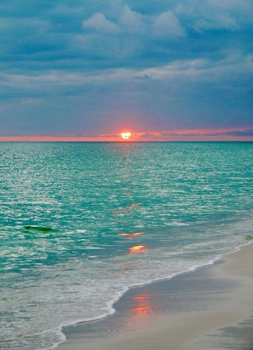 Gorgeous turquoise water and orange sunset...I would love to see this sunset....