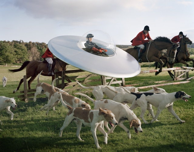 Kinga Rajzak in flying saucer with members of the West Percy Hunt  Eglingham Hall, Northumberland, 2009