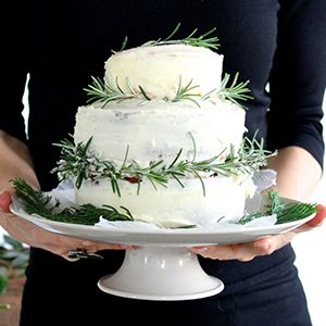 Snowy White Cake with Rosemary Peppermint Icing by Imen McDonnell.   A snowy white decadent cake, perfect for festivities.