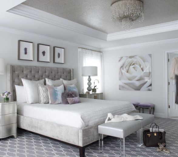 Glam white bedroom with grey tufted headboard and acrylic accents by @susanglickinteriors