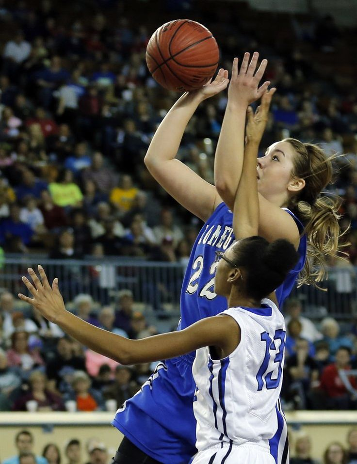 Lomega's Rachel Yost shoots as Coyle's Adonica Sumlin during the Class B girls high school basketball championship game between Lomega and Coyle at the Jim Norick Arena, aka The Big House, at State Fair Park in Oklahoma City, Saturday, March 7, 2015. Photo by Sarah Phipps, The Oklahoman