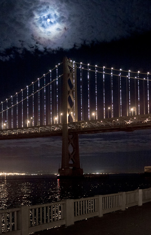 """""""Bay Lights"""": San Francisco's Bay Bridge is about to become the world's largest light sculpture, with 25,000 LED lights programmed to create unique sparkling patterns--never repeating a pattern in it's scheduled 2 year lifespan.  The project goes live March 5, 2013.   Design: Leo Villareal (2013)"""