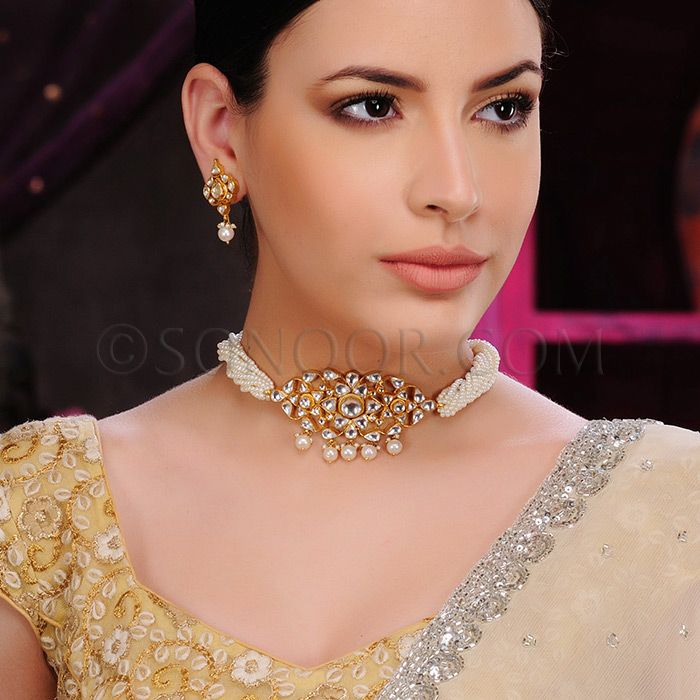 PEN/1/3416 Kesha Pendant Set (Choker Style) with Earrings in dull gold finish studded with kundan stones stringing in fresh water pearls 	 $198	 £117