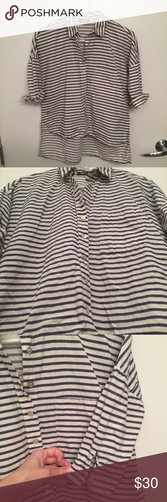 "Urban Outfitters Striped ""High-Low"" Button Down Half sleeves with cuffs. In photos cuffs are flipped up. 100% cotton. Very soft and light weight. I've worn this to warm destinations.. Key West, and, as pictured, in Costa Rica. Will try to find more style pics (know I have some saved elsewhere). Very good used condition. Pearlescent buttons down front and at cuffs. Slits are both sides. Front of top hits me at right about the top of a regular pair of pants. **NON-SMOKING HOME** Not interested…"