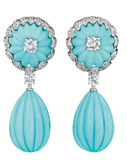 A Pair of Turquoise and Diamond Ear Pendants by Vita. Each designed as a carved turquoise drop, from a carved turquoise surmount, centering on a circular-cut diamond, to the pavé-set diamond surround, mounted in 18K white gold, length 2 inches.Signed 'Vita