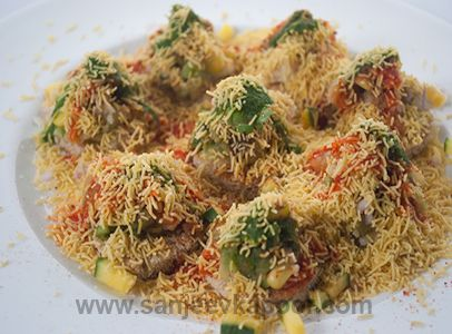 Bread Sev puri - This sev puri has no puris but crisp bread roundels as the base.