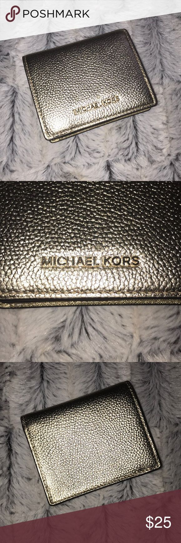 New! Michael Kors Money Pieces Wallet! This wallet is brand new and has never been used! It is about the size of a men's wallet. Super cute! It is gold. But when it reflects light, it looks silver. KORS Michael Kors Bags Wallets