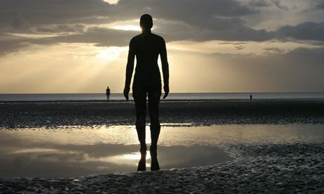'Another Place'. 100 bronze figures covered and revealed by the tide at Crosby Beach near Liverpool, England by Anthony Gormley.