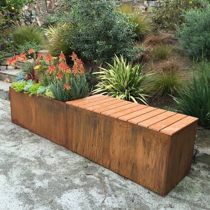 "corten steel metal planter with polystyrene bench - Could be done with a 60"" reclaimed metal cubicle overhead. Reclaimed cedar would be nice for the bench piece."