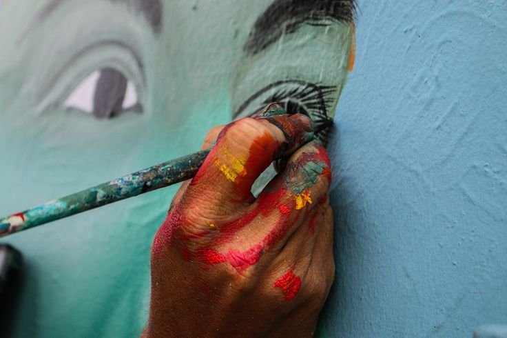 Aaron Glasson in progress on his mural at Perfume Point.