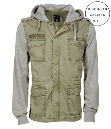 """This Brooklyn Calling Hooded Full-Zip Military Jacket blends elements of army-inspired styling with modern deets for an edgy, urban look. It features four flap pockets on the front, snap epaulettes at the shoulders, and hidden camo-print accents. The sleeves and hood are crafted with cozy knit fabric for an unexpected finish.<br><br>Authentic fit. Approx. length (M): 28.5""""<br>Style: 4314. Imported.<br><br>100% cotton.<br>Machine wash/dry."""