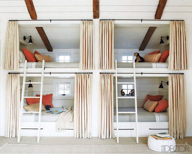 The fir-paneled walls in the bunk room are painted in Farrow & Ball's Pointing, and the ladders and bunk beds are custom made;  the pillows are covered in Rogers & Goffigon fabrics, and the curtains are of a linen by  Rose Tarlow Melrose House.