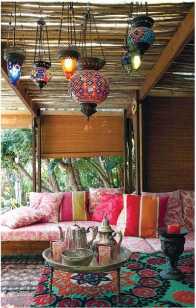 love the lanterns and mix of shapes and patterns in the pillows. room idea.