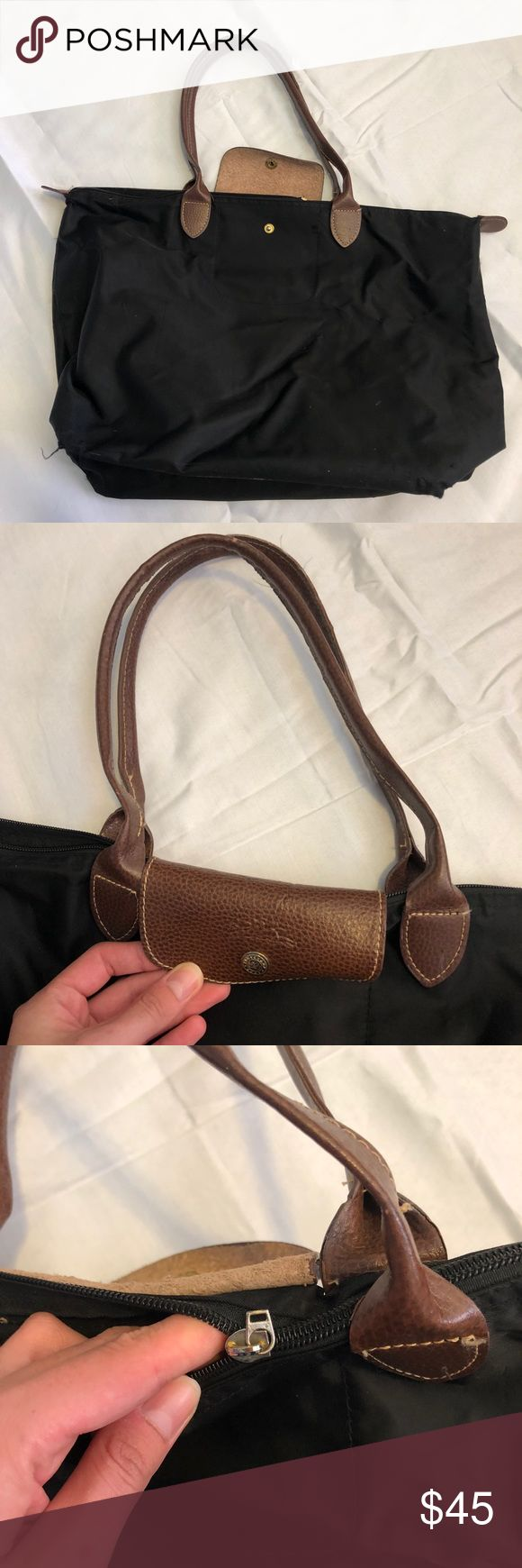 """Longchamp bag Worn, definitely used. Zipper part broke but can still be closed / open. Not too dirty, as I kept a bottom at the bottom to prevent it from getting dirty. Not sure if 100% authentic. I ordered from eBay, and it came from """"China"""" so when i received it I was always on the edge of whether it was authentic or not, but the price was great and I can't tell a difference so I kept it. Let me know if any questions! Longchamp Bags"""