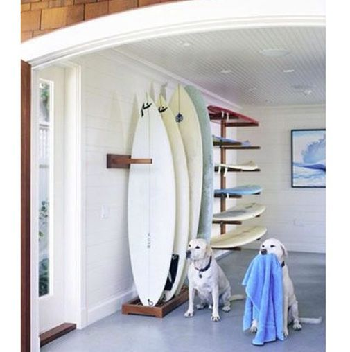 Awesome surfboard rack set-up and two very cute dogs.