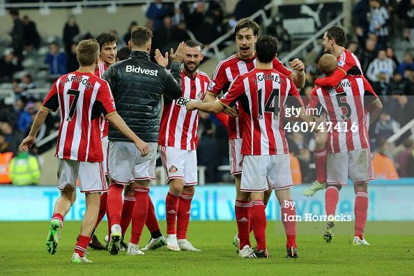NEWCASTLE, UNITED KINGDOM - DECEMBER 21: Sunderland players celebrate the win at the end of the game during The Barclays Premier League match between Newcastle United and Sunderland AFC at St James' Park on December 21, 2014 in Newcastle upon Tyne, England. (Photo by Ian Horrocks/Sunderland AFC via Getty Images)