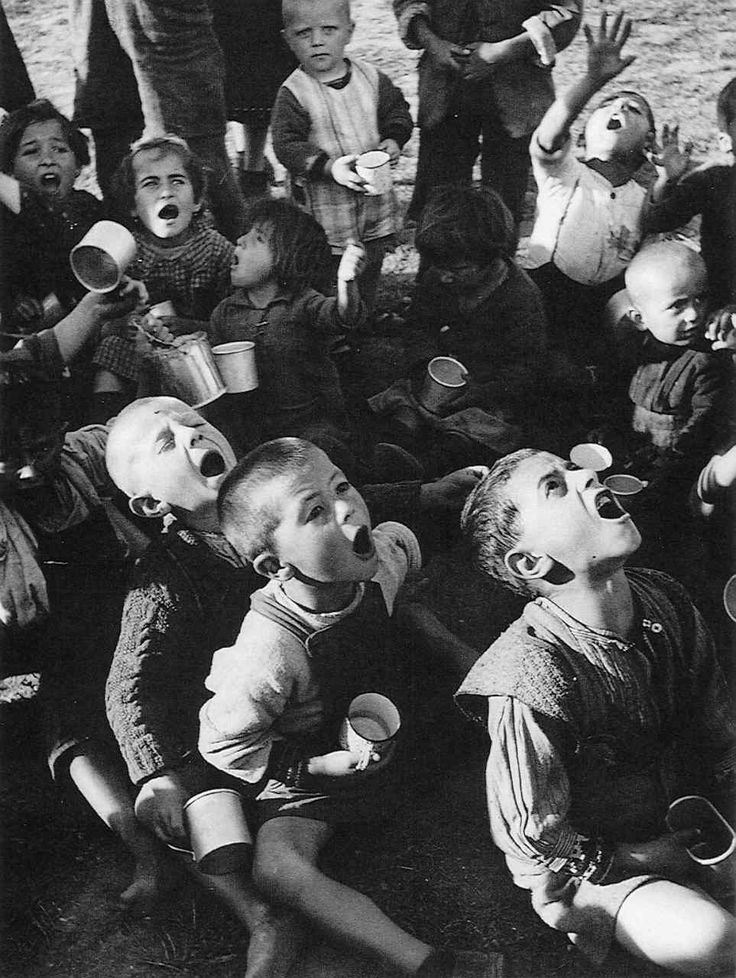 1948 Hungry Greek children waiting for their rations of powdered milk --