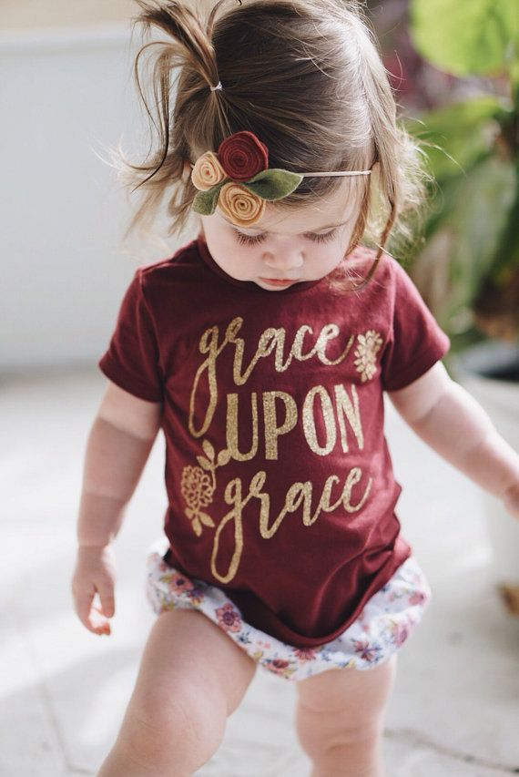 Our Grace Upon Grace design, now in Fall colors! This scripture tee can be worn at any time of year, but the burgundy and gold combo is perfect for your toddlers Fall wardrobe. Default design color is gold GLITTER. Please leave a note if you would prefer just solid gold.     [please note: 6M-18M tees are a slightly paler shade of maroon. Thats just the way the shirts are from the supplier.]  Thanks for shopping with Sweet Peony! Please let me know if you have any questions…