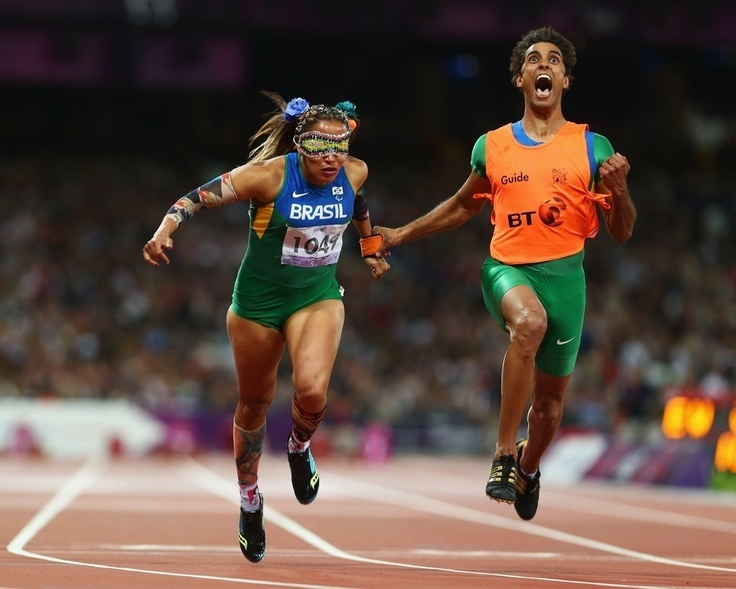 The Most Inspiring Sports Photos of 2012, via @BuzzFeed. Seen Here: Guide Guilherme Soares de Santana reacts to blind Paralympian Terezinha Guilhermina of Brazil winning gold before she knows she's won the Women's 100m T11 Final.