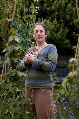 Ruby Blume, seen in her Oakland, Calif., is an urban homesteader with quail, rabbits and beehives. She founded the Institute of Urban Homesteading