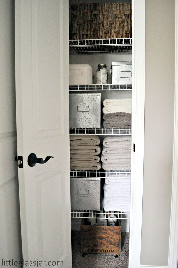 Loving how this linen closet is organized. Not too complicated